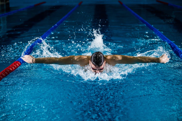 Free Amazing Sports Backgrounds for Designers: Beautiful Swimming Photograph